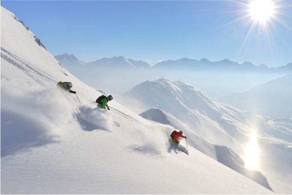 three people skiing