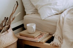 mug next to a bed
